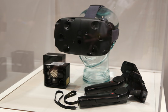 """The HTC Vive HMD with controllers and """"Light House"""" Sensors"""